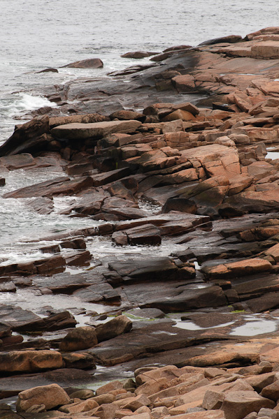 The rocky coast of massive granite boulders at Halibut Point, Rockport, MA