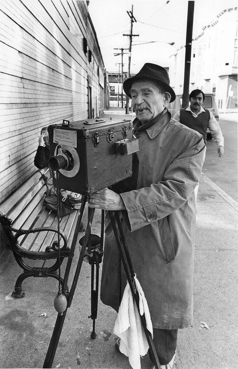 Street photographer, Chelsea, MA, 1981