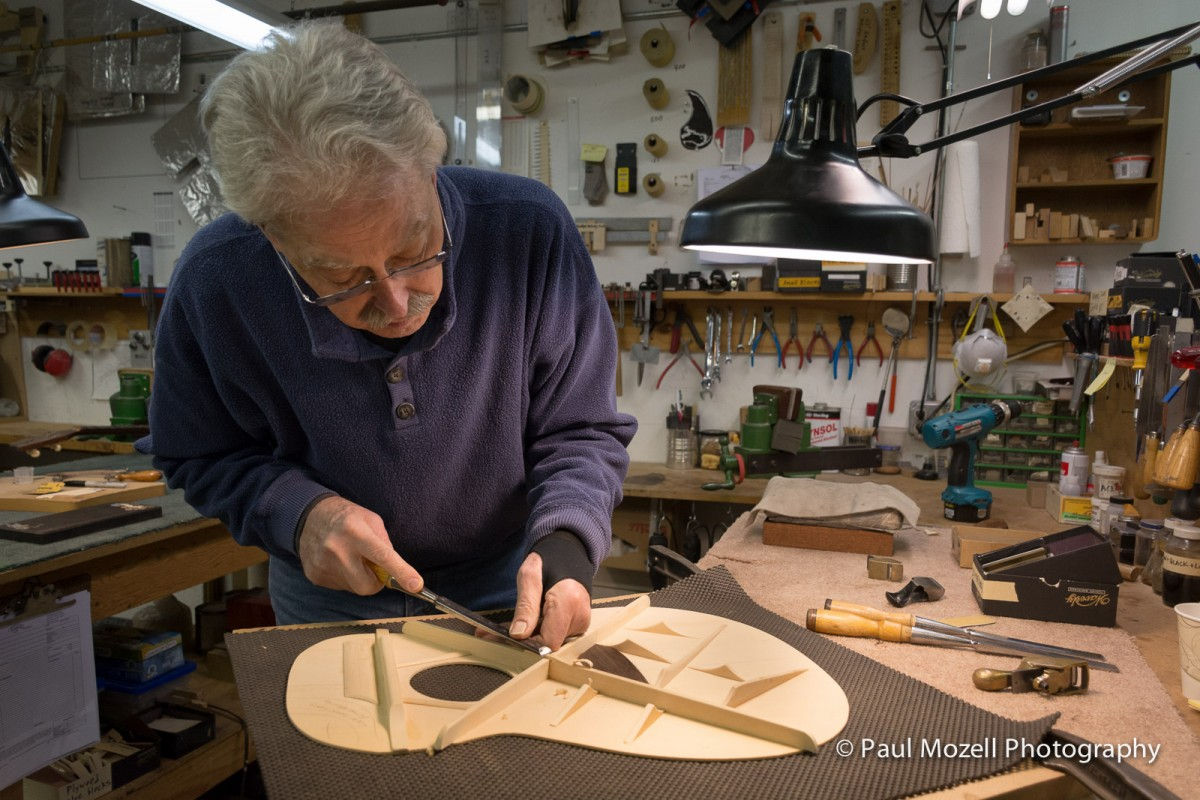 Shaping the braces on a spruce top.