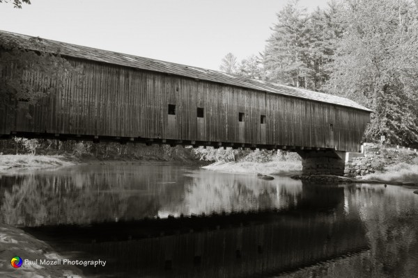The Hemlock Bridge is a covered bridge in a rural part of Fryeburg, Maine. Built in 1857, it carries Hemlock Bridge Road over the Old Course Saco River, near the western shore of Kezar Lake in eastern Fryeburg.
